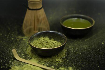 green matcha tea over black background  Standard-Bild