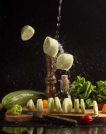 falling of fresh cucumber slices Standard-Bild