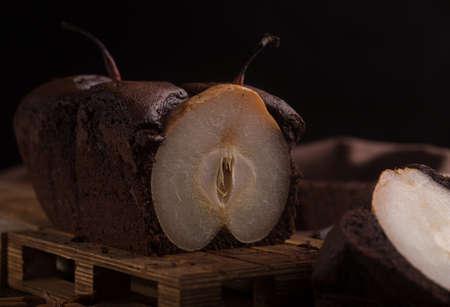 pear tart tatin, french caramel pear cake, dark background