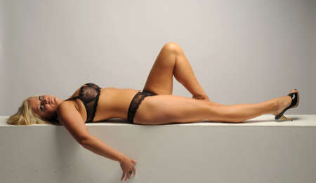 Sexy blond woman led in black lingerie