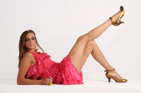 Sexy young woman in pink dress and high heels