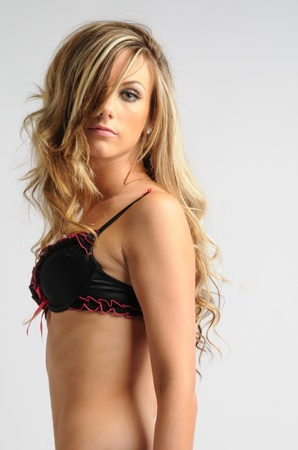 sexy young blonde woman wearing black lingerie
