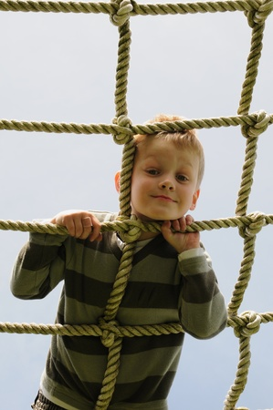 young boy on climbing ropes