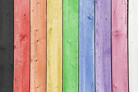 Nine rainbow coloured timber planks