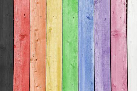 Nine rainbow coloured timber planks