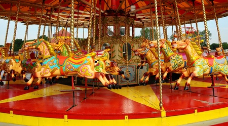 Colourful Horses on a merry-go-round carousel Stock Photo