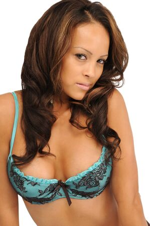 A sexy young brunette woman in a blue lacy bra Stock Photo