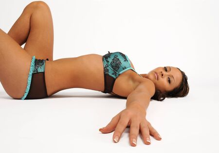 A sexy young woman led on her back in lingerie Stock Photo