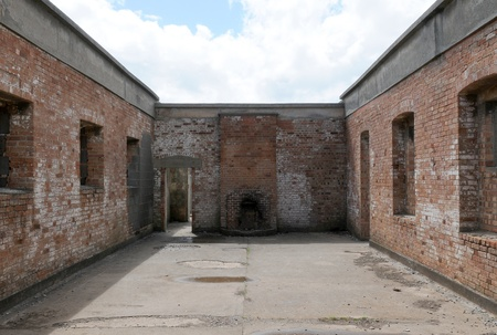 An old abandoned brick built building without a roof