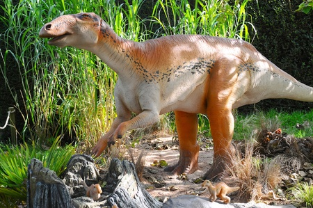 large model of an Edmontosaurus dinosaur with babys in nest site
