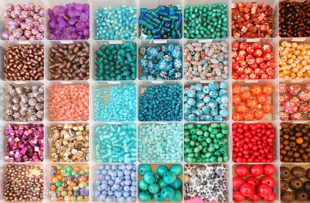 Large collection of colourful beads in boxes
