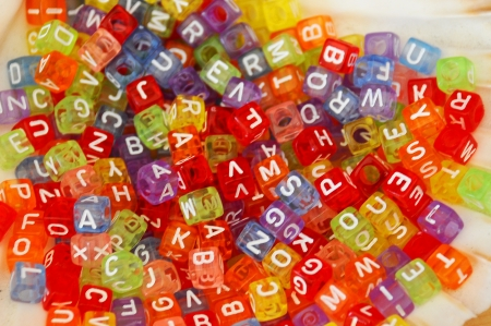 colourful collection of lettered beads Stock Photo