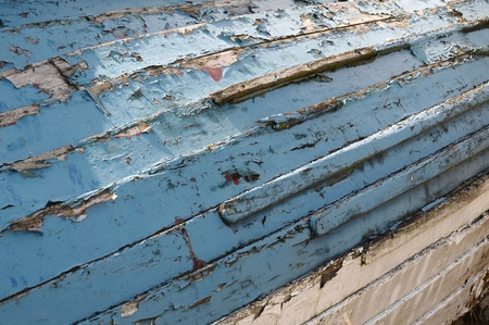 close up of the hull of an old boat in a distressed and worn  condition