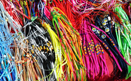 a large collection of coloured and beaded strings  braids Stock Photo