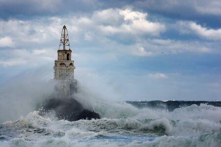 seaway: Lighthouse in the port of Ahtopol, Black Sea, Bulgaria Stock Photo