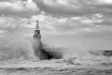 seaway: Lighthouse in the port of Ahtopol, Black Sea, Bulgaria,black and white