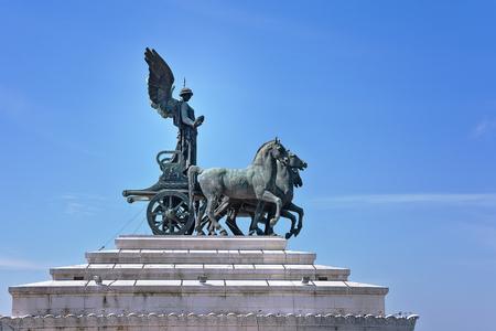 Quadriga on top of Monument Vittorio Emanuele II in Rome. Statue of goddess Victoria riding on quadriga