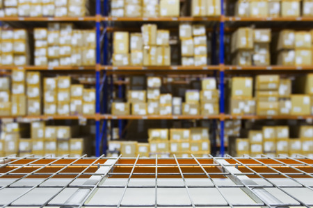 empty warehouse: empty warehouse shelves with defocused  background on racking