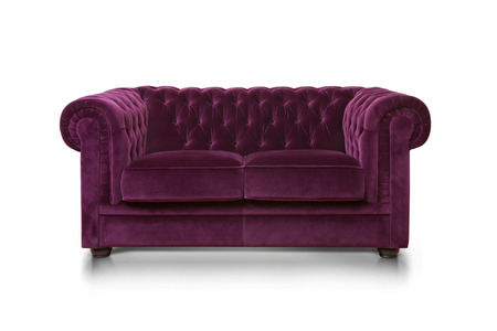 couch: Purple luxurious sofa isolated on white background, front view.