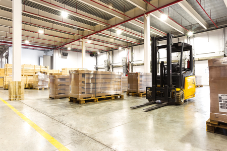 New Large modern storehouse with some goods Foto de archivo