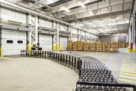 unloading: Warehouse, unloading with conveyor belt Stock Photo