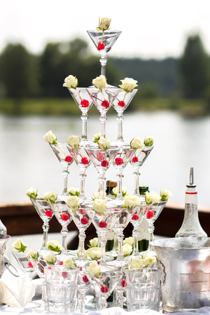Pyramid of Champagne Glasses with Dry Ice Vapor Ready for Cocktails
