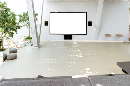 Conference room interior with a white wall and large white scree