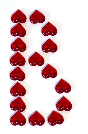 big letter B on white background made of red hearts