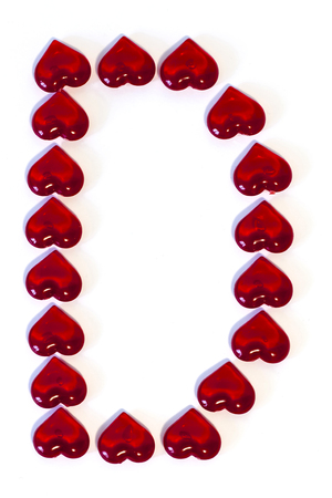 the big letter D on a white background is made of red hearts Standard-Bild