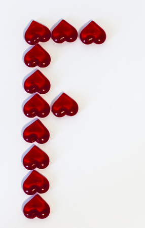 the big letter F on a white background is made of red hearts