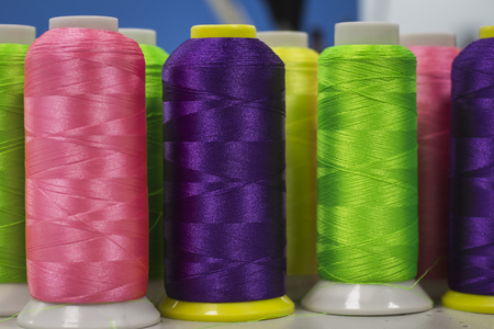 thread trendy colors in rolls ,for the manufacture of embroidery.