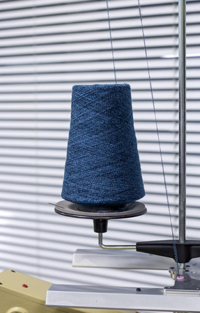 the thread of blue on a modern machine for the connection of the knitted parts.