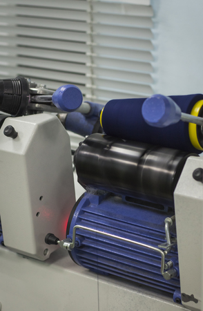 blue thread on a modern machine for rewinding threads.
