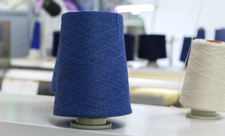 blue thread on a modern knitting machine.