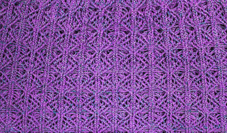 Unusual abstract background of purple knitted fabric texture. Archivio Fotografico