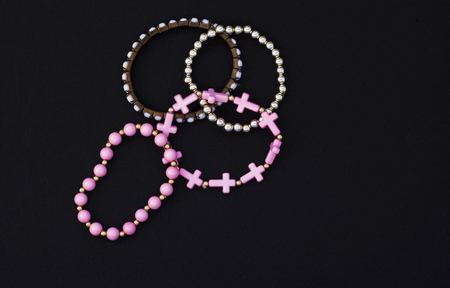 set of womens beautiful bracelets on black background with copy space.