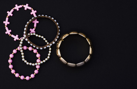 set of beautiful womens bracelets on black background .Flat lay, top view, copy place.