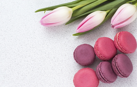 festive composition, delicate tulips and almond cookies on the table.copy space Stock Photo