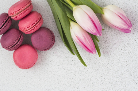 festive composition, tulips and macaroons on the table.copy space