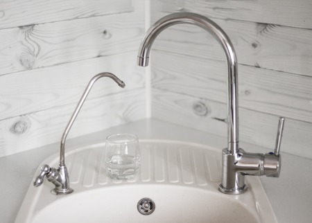 kitchen sink with drinking purified water tap through filter and tap tap with tap water.