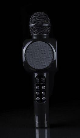 black modern karaoke microphone on black background.