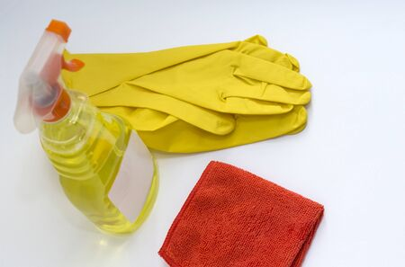 Cleaning concept.yellow spray cleaner with gloves and cloth top view