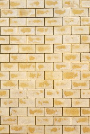 texture and background of yellow pavers on the roadway