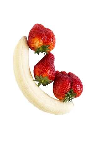 Isolated fruit peeled banana and three strawberries on white background. Imagens - 133846586