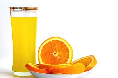 orange juice with oranges isolated on white. Imagens