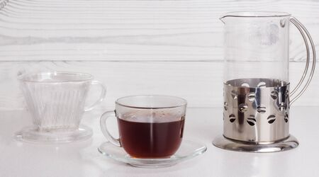 ready coffee in a transparent glass Cup, brewed in an alternative way in a funnel v60. Imagens - 135477263