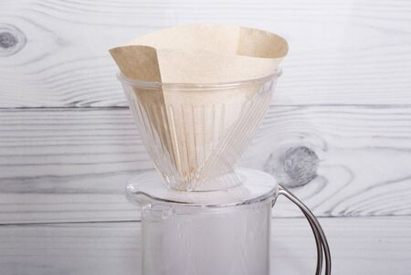 new filter for subsequent alternative brewing of coffee in the funnel v60. Imagens - 135477268