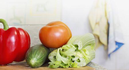 fresh vegetables cooked for salad on kitchen background.