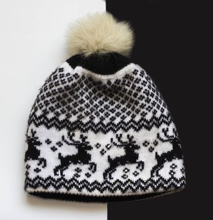 winter black and white hat with funny Christmas pattern on black and white background. Imagens - 134931621