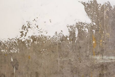 background in the process of updating gray concrete walls with putty